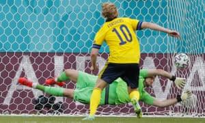 Sweden's Emil Forsberg kicks the ball past Slovakia's goalkeeper Martin Dubravka to open the scoring