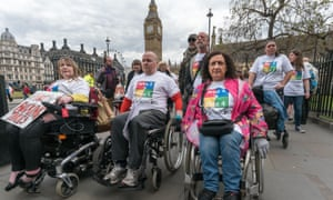 Members of Disabled People against Cuts protest outside the Conservative party headquarters in London in May 2017.