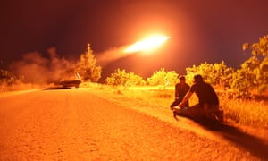 Hama province, Syria. Syrian fighters from the Turkish-backed National Liberation Front (NLF) fire a missile against jihadist positions in north-western Syria.