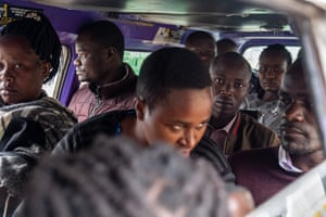 people crammed into one of the smaller matatus, a Toyota van