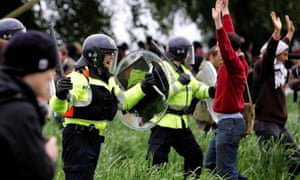 Police clash with activists who broke through a fence surrounding the G8 summit at Gleneagles in July 2005