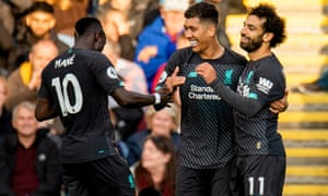 Roberto Firmino is congratulated by his teammates after scoring Liverpool's third goal against Burnley.
