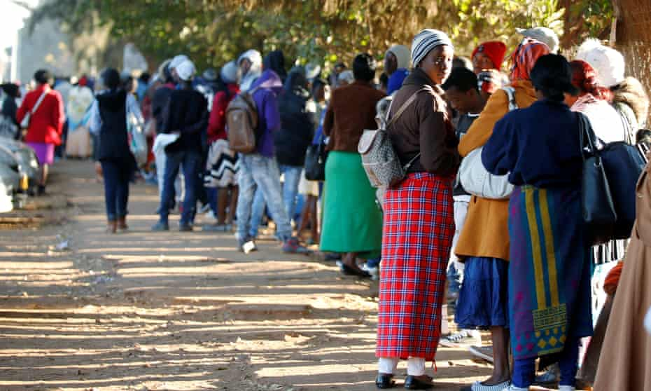Zimbabweans queue outside a Home Affairs Department office to apply for passports in Harare, Zimbabwe, July 3, 2019. REUTERS/Philimon Bulawayo