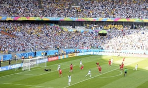 The stadium erupts as Lionel Messi (right) wheels away in celebration after his shot beats Iran's goalkeeper Alireza Haghighi.