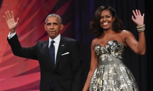 Barack Obama and Michelle Obama say they will donate a 'significant portion' of their book proceeds to charities.