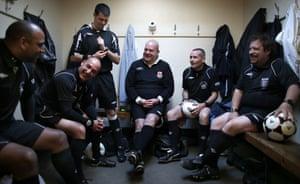 Referees share a joke at Hackney Marshes.
