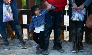 Central American migrants turn themselves in to the US border patrol as they seek asylum in Texas.