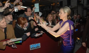 JK Rowling signs copies of her books for fans in 2008.