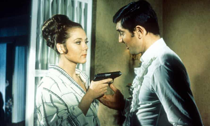 George Lazenby and Diana Rigg.