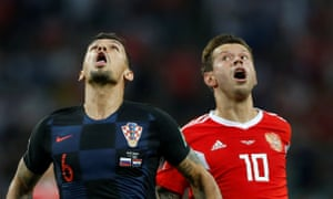 Croatia's Dejan Lovren and Russia's Fyodor Smolov compete in the old catching a fly in the mouth competition.