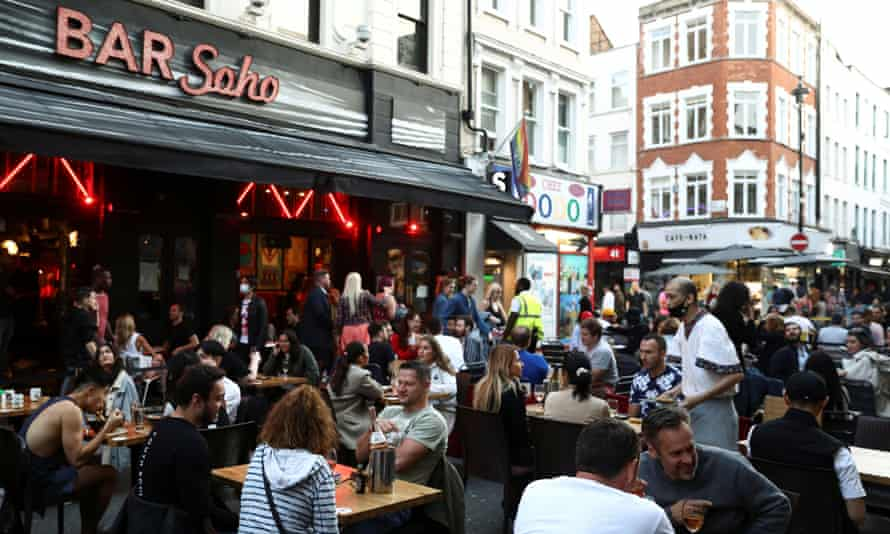 Alfresco dining in Soho last September. Restrictions on outdoor drinking and eating are due to be lifted next month.