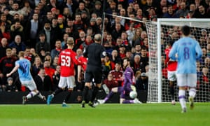 Manchester City's Kevin De Bruyne shoots before Manchester United's Andreas Pereira scored an own goal and the third for Manchester City.