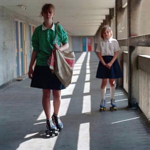 Roller-skating paper girls Anita and Emma at the Hyde Park Flats, 1988.