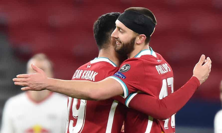 Nathaniel Phillips and Ozan Kabak celebrate a win and a clean sheet against Leipzig.