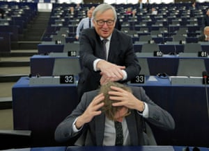 Strasbourg, France: The European commission president, Jean-Claude Juncker, jokes with Guy Verhofstadt, the EU's chief Brexit negotiator, before a debate on the future of Europe
