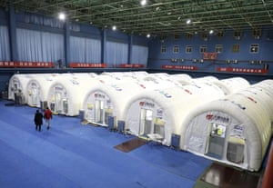A photo distributed by Chinese state media of a temporary Covid-19 testing laboratory built on an indoor tennis court in Hebei