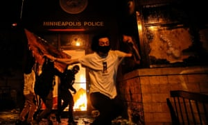 Protesters set fire to the entrance of the 3rd precinct police station as demonstrations continued in Minneapolis.