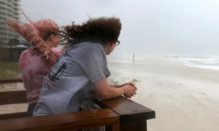 Jordan Spence and Dawson Stallworth watch waves come ashore as Hurricane Sally approaches in Orange Beach, Alabama Tuesday.