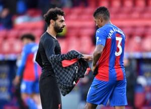 Salah passes his shirt to Van Aanholt after the match.