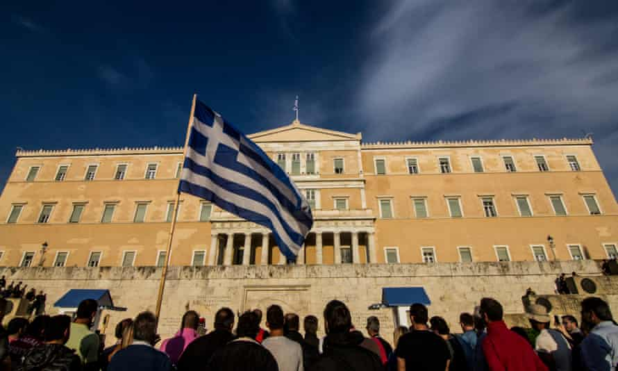Greeks protest against austerity outside the parliament building in Athens