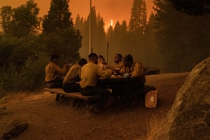 Firefighters take a break. Nearly 15,000 firefighters battled some two dozen fires across the state on Sunday