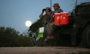 Members of the national guard patrol along the Rio Grande at the Texas-Mexico border in Rio Grande City, Texas.