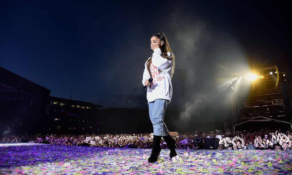 'We put a lot on her shoulders' ... Grande wipes away a tear as she performs at One Love Manchester, Old Trafford cricket ground, 4 June 2017.