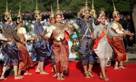Cambodian dancers perform during a prayer ceremony in front of Angkor Wat temple.