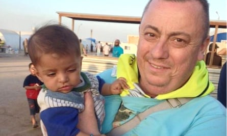 Alan Henning and a child