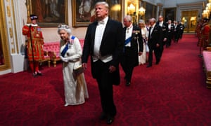 Queen Elizabeth and Donald Trump pass through the East Gallery of Buckingham Palace as they head to a state banquet, on the first day of the US president's three-day state visit to the UK.
