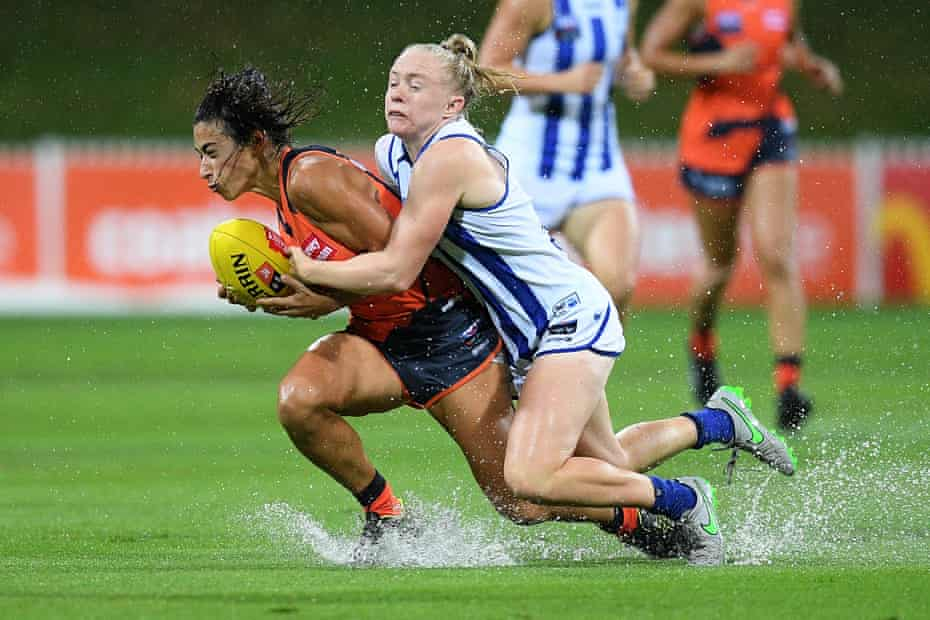 Amanda Farrugia of the Giants is tackled by Emma Humphries of the Kangaroos during the Round 2 AFLW match between the GWS Giants and the Kangaroos at Drummoyne Oval in Sydney.