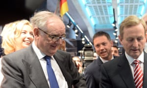 Arthur Ryan, left, with the Irish taoiseach, Enda Kenny, right, at the opening of a Primark store in Berlin in 2014.