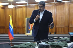 Venezuelan President, Nicolas Maduro displays seized armament and passports after a meeting with members of the Armed Forces in Caracas, Venezuela on May 4, 2020. Maduro confirmed the detention of two US mercenaries among 13 attackers involved in Sunday's two failed maritime raids.