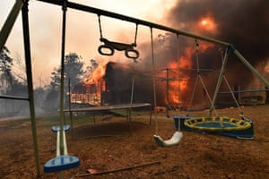 A home lost to a bushfire on Hassall Road in Buxton as the Green Wattle Creek fire threatens a number of communities in the south west of Sydney.