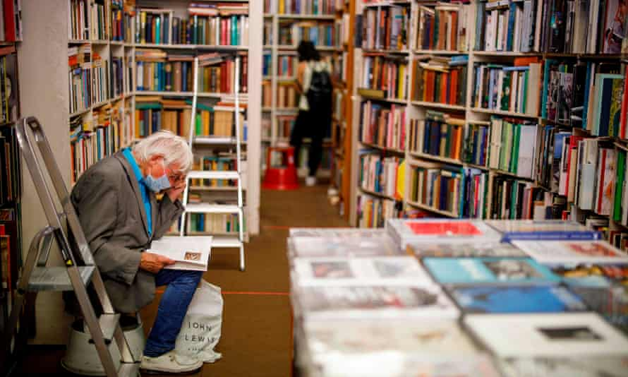 A customer browses in Henry Pordes secondhand bookshop in London in June 2020.