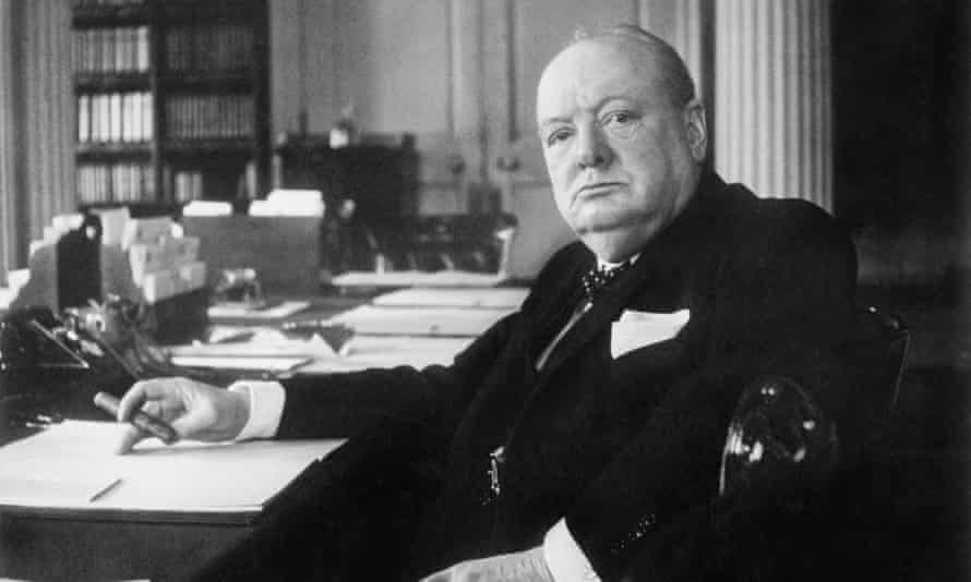 Winston Churchill at his seat in the Cabinet Room at 10 Downing Street, London, circa 1940.