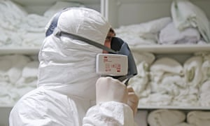 A medical worker puts on protective gear at a hospital in Makhachkala