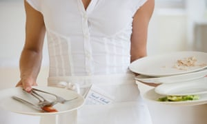 Waitress holding dirty platesGettyImages-77817074