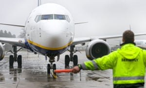 A Ryanair plane being guided to park in Weeze, western Germany.