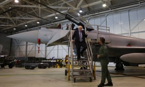 Boris Johnson walking down steps while talking to Group Captain Chris Layden after he viewed a Typhoon fighter jet at RAF Lossiemouth, Moray.