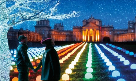 Couple look at illuminated front of Blenheim Palace