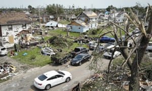 Residents clean up a tornado-damaged neighborhood, Wednesday in Dayton, Ohio.