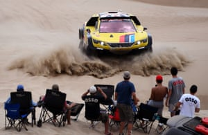 Stage One: Lima, Peru, to Pisco, PeruSpectators get a good view of Peugeot driver Harry Hunt and co-driver Wouter Rosegarr