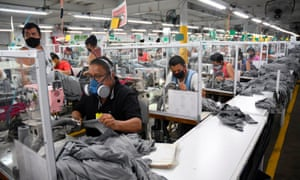 Workers wear face masks as a preventive measure against the spread of the coronavirus at the textile plant KP Textil in San Miguel Petapa, on 10 July.