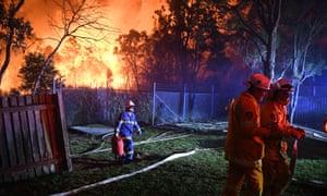 A bushfire in south-western Sydney burns out of control.