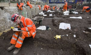 Archaeologists work at the Bethlem burial ground in London.