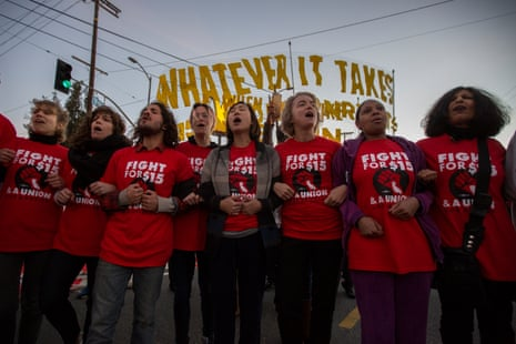 Striking McDonald's restaurant employees lock arms in an intersection before being arrested, after walking off the job to demand to demand a $15 per hour wage and union rights during nationwide 'Fight for $15 Day of Disruption' protests on November 29, 2016 in Los Angeles, California.