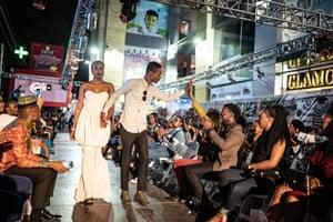 Designer Richie Maya walks the catwalk after the models have shown off his work
