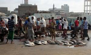 Fishermen selling their catch along the shore in Hodeidah, Yemen