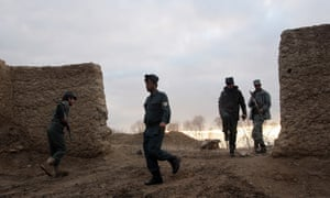 Afghan policemen walk into a police station in Lashkar Gah, capital of Helmand province, Afghanistan, in December 2015. Helmand remains a battleground between the Taliban and the US-backed Afghan military.